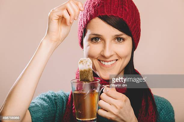 Woman holding a teabag