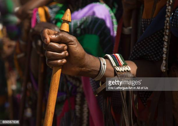 Woman holding a traditional stick with a phallic shape during the Gada system ceremony in Borana tribe Oromia Yabelo Ethiopia on March 7 2017 in...