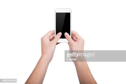 Woman holding a white mobile phone : Stock Photo