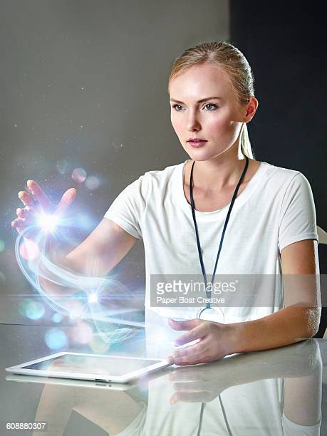 Woman holding abstract hologram glow