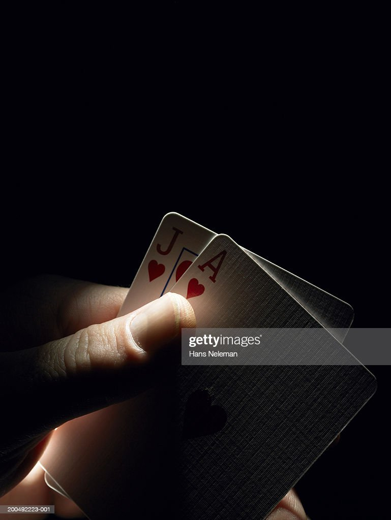 Woman holding ace and jack of hearts, close-up : Stock Photo