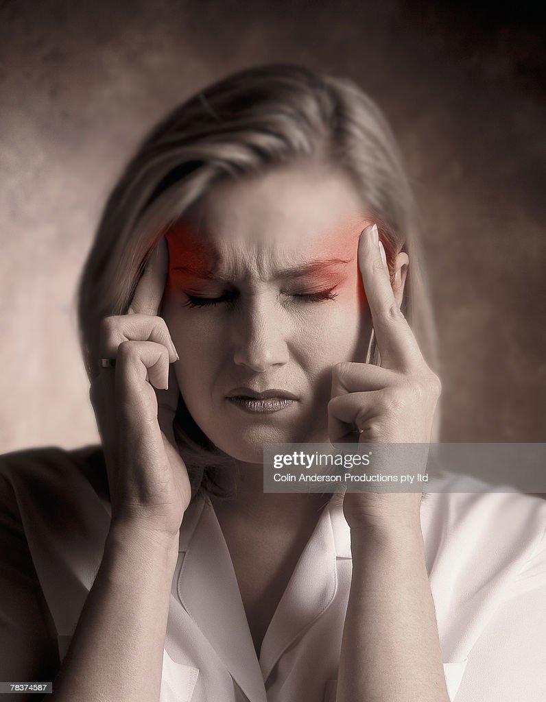 Woman holding aching temples : Stock Photo
