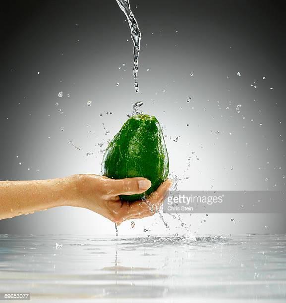 Woman holding an Avocado