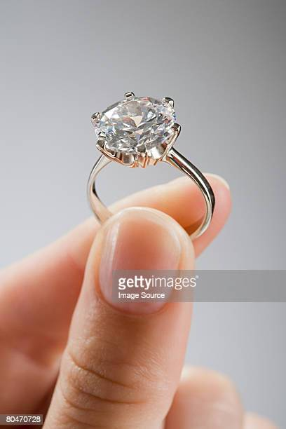 A woman holding an engagement ring
