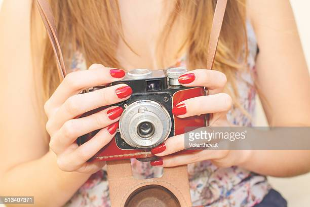 Woman holding an old vintage camera