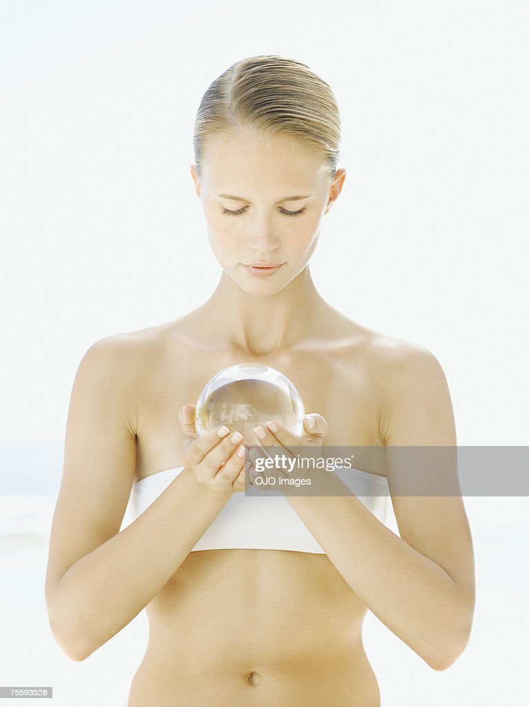 Woman holding an orb in her hands : Stock Photo