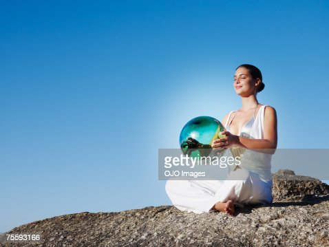 A woman holding an orb : Stock Photo