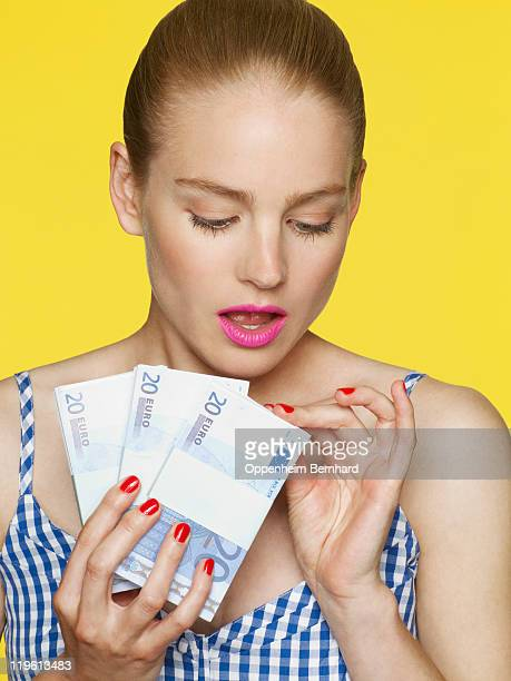 Woman holding and counting money