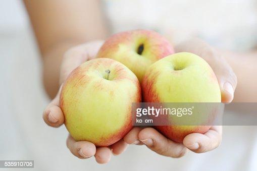 Woman holding apple. : Stock Photo