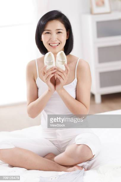 Woman holding baby shoes