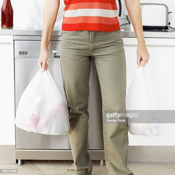 woman holding bags of groceries