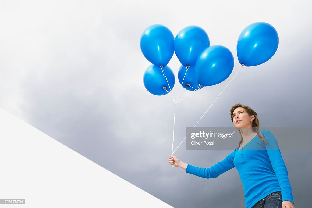 Woman Holding Balloons : Stock Photo