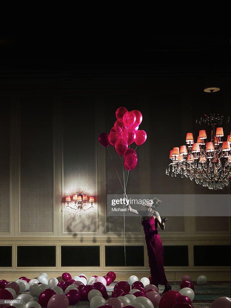 Woman holding balloons  : Stock Photo