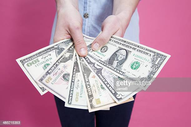 Woman holding banknotes