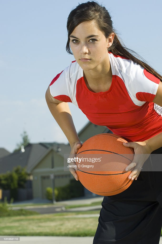 Woman holding basketball : Stock Photo