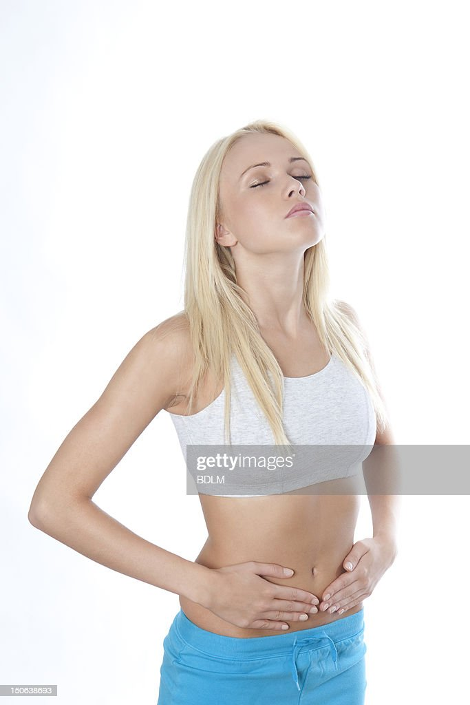Woman holding belly