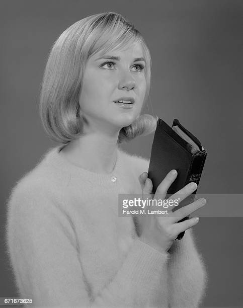 ' Woman Holding Bible, Looking Up'