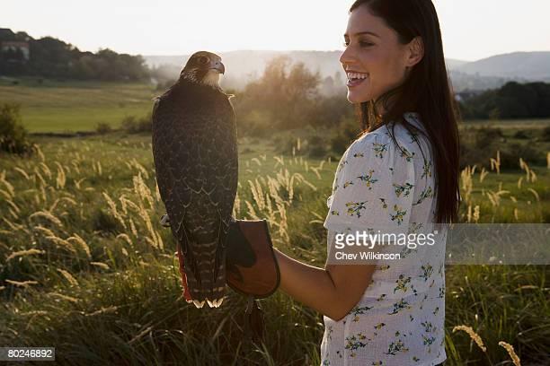 Woman holding bird.
