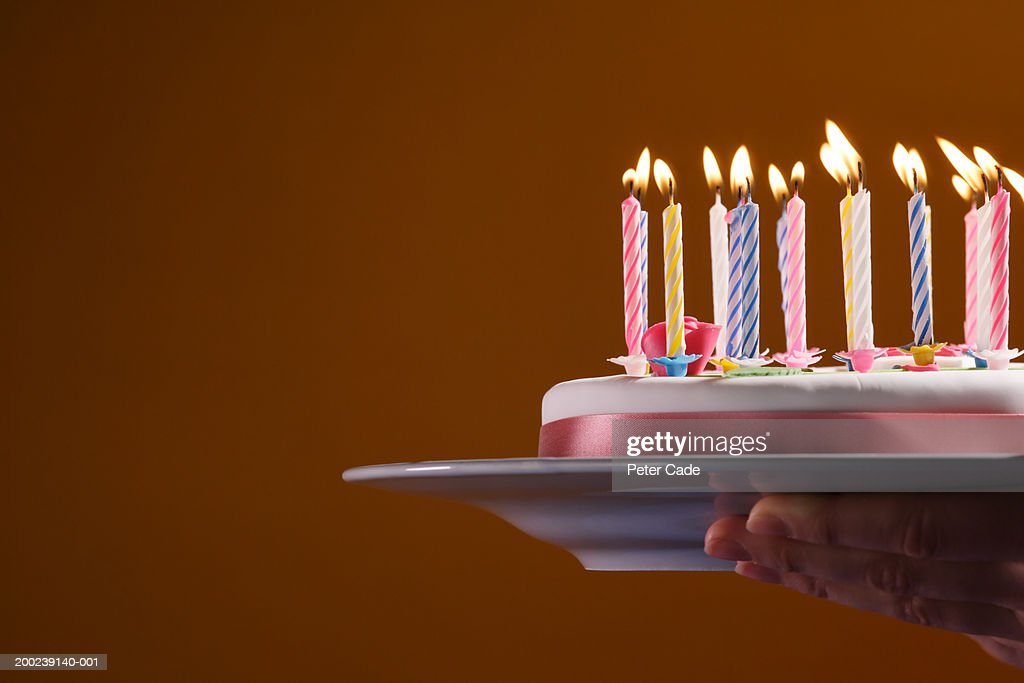 Woman Holding Birthday Cake On Serving Plate Side View Closeup