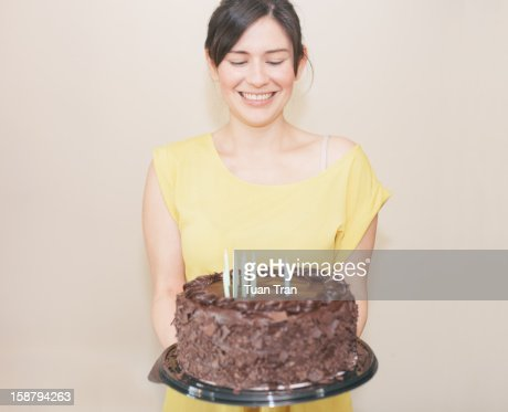Woman holding birthday cake : Stock Photo
