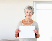 Woman holding blank sheet of paper