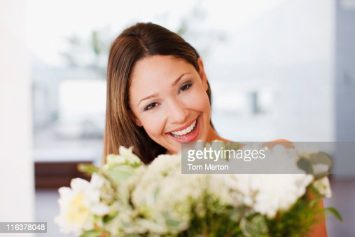Woman holding bouquet of flowers : Stock Photo