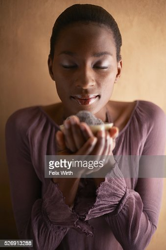 Woman holding bowl of chocolates : Stock Photo