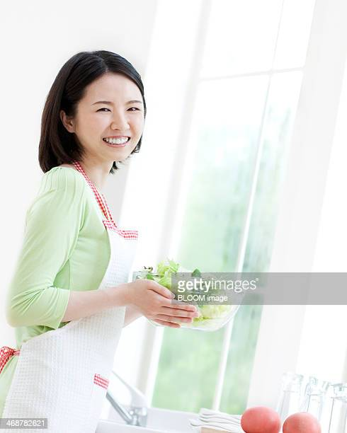 Woman Holding Bowl Of Vegetables