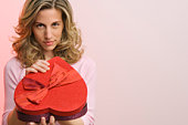 Woman holding box of Valentine's Day candy