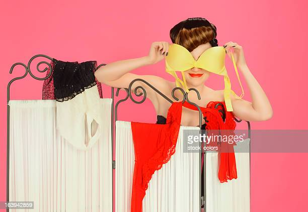 woman holding bra