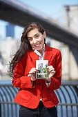 Woman holding Brooklyn Bridge postcard, New York City, New York, USA