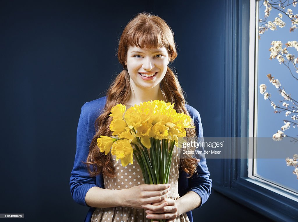 Woman holding bunch of daffodils. : Stock Photo