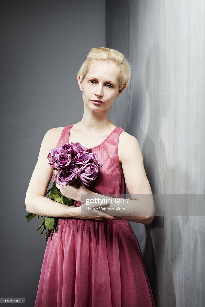 Woman holding bunch of roses. : Stock Photo