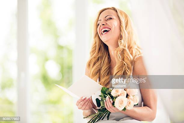 Woman holding bunch of roses