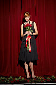Woman holding bunch of roses standing on theatre stage