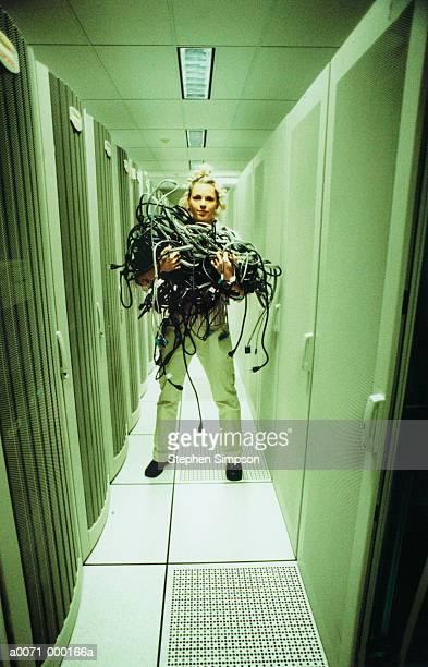 Woman Holding Bundle of Wiring