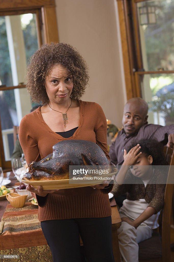 Woman holding burned turkey