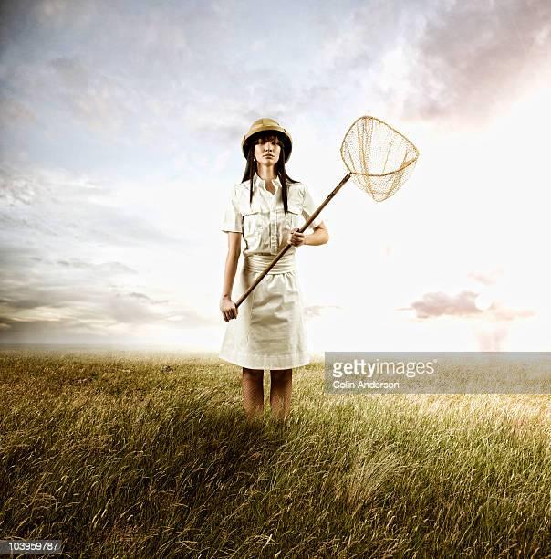Woman Holding Butterfly Net