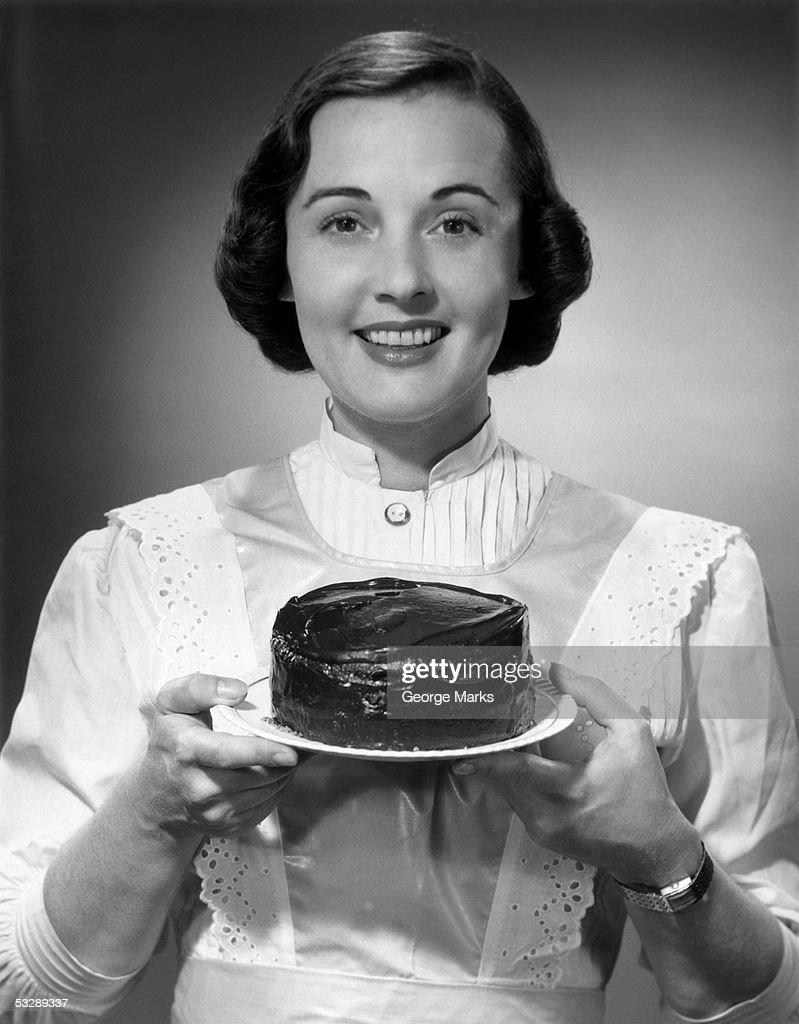 Woman holding cake : Stock Photo