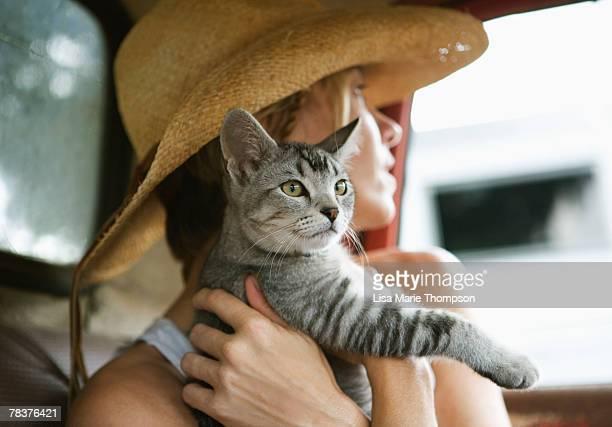 Woman holding cat
