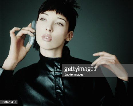 Woman Holding Cell Phone to Ear : Stock Photo
