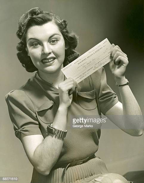 Woman holding check