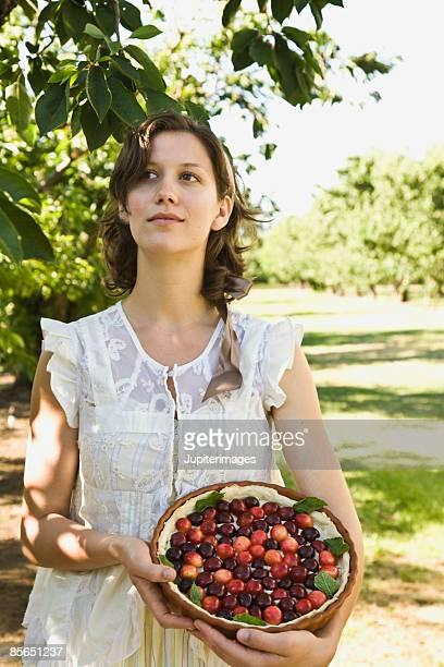 Woman holding cherry tart