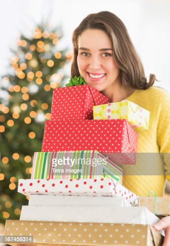 Woman holding christmas gifts : Stock Photo