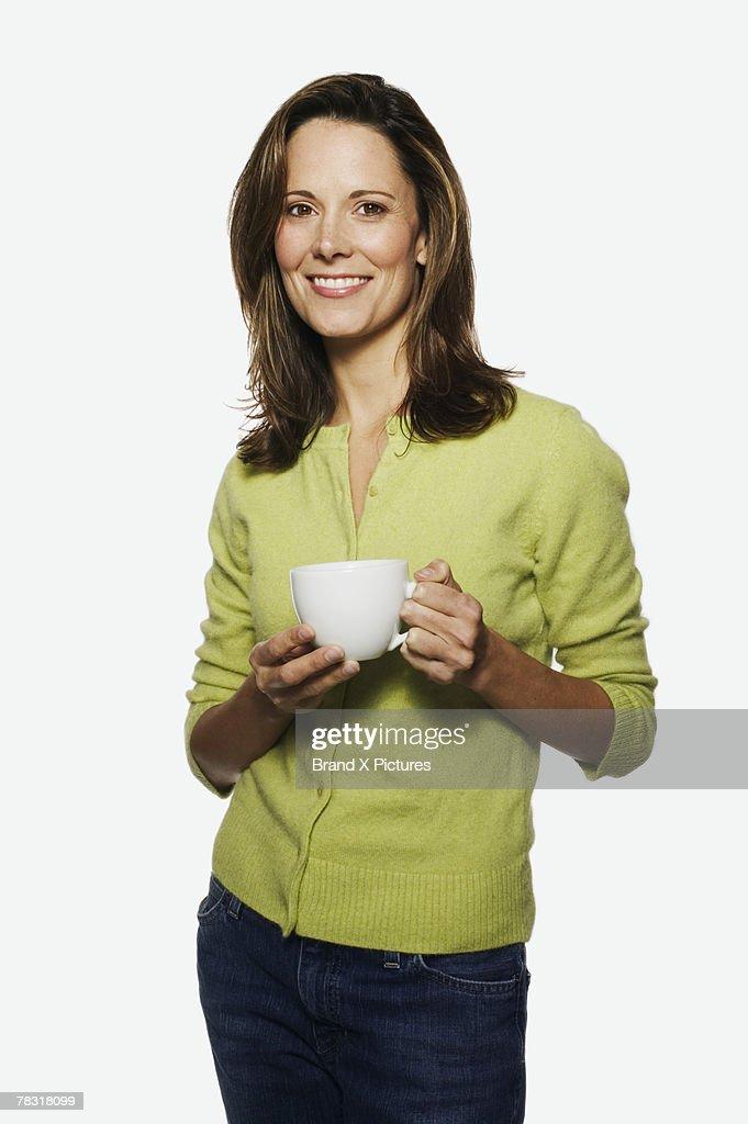 Woman holding coffee : Stock Photo