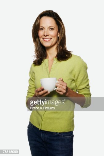 Woman holding coffee : Stock Photo