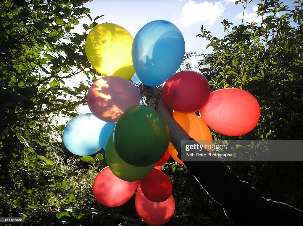 Woman holding colorful balloons : Stock Photo