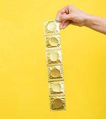 Woman holding condoms