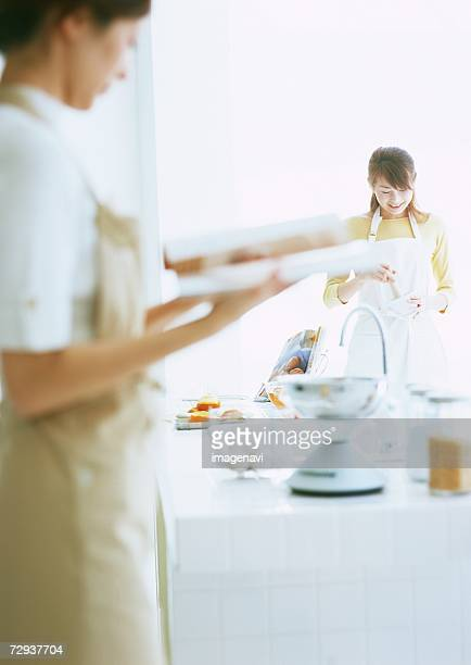 Woman holding cooking book