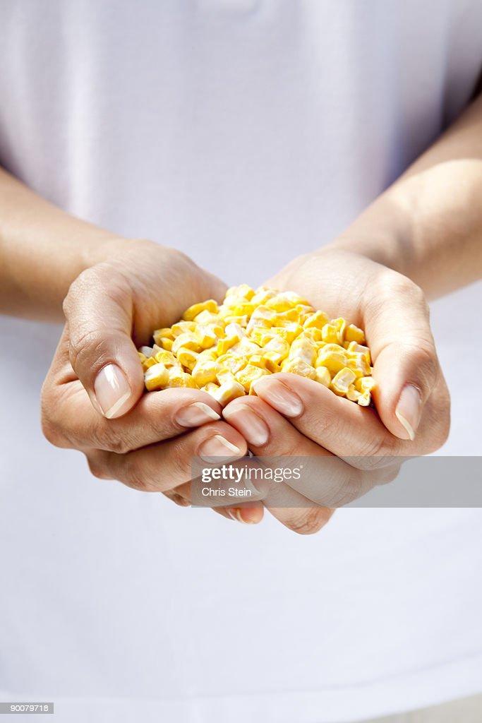Woman holding corn kernels